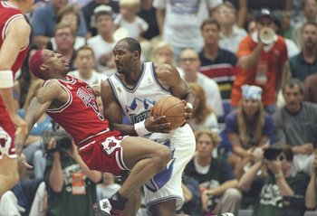 8 Jun 1997: Dennis Rodman (left) of the Chicago Bulls is hit hard by Karl Malone of the Jazz during the Bulls 73-78 loss to the Utah Jazz in Game 4 of the NBA Finals at the Delta Center in Salt Lake City, Utah.