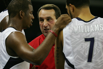 MACAU, CHINA - AUGUST 01:  Head coach Mike Krzyzewski talks with Chris Paul #13 and Deron Williams #7 of the USA Basketball Men's Senior National Team during the USA Basketball International Challenge exhibition game against the Turkey National Team at th