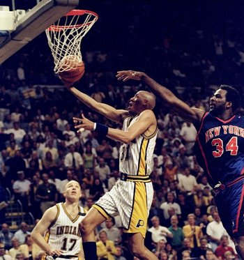 13 May 1998: Reggie Miller #31 of the Indianapolis Pacers jumps to make a lay-up as Charles Oakley #34 of the New York Knicks reaches to block at Market Square Arena in Indianapolis, Indiana. The Pacers defeated the Knicks 99-88. Mandatory Credit: Vincent