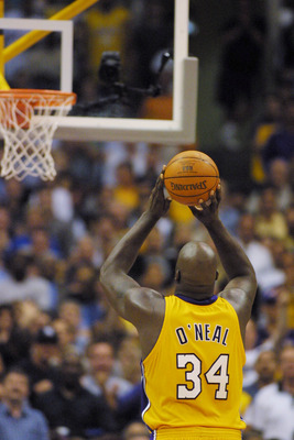 6 Jun 2001:  Shaquille O''Neal #34 of the Los Angeles Lakers puts up a free-throw against the Philadelphia 76ers in game one of the NBA Finals at Staples Center in Los Angeles, California.  The 76ers won 107-101.  DIGITAL IMAGE.  Mandatory Credit: Jed Jac