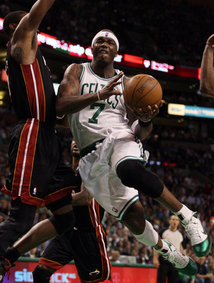 BOSTON, MA - MAY 09: Jermaine O'Neal #7 of the Boston Celtics drives past Mario Chalmers #15 of the Miami Heat in Game Four of the Eastern Conference Semifinals in the 2011 NBA Playoffs on May 9, 2011 at the TD Garden in Boston, Massachusetts.  NOTE TO US