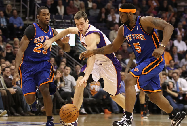 PHOENIX, AZ - JANUARY 07:  Goran Dragic #2 of the Phoenix Suns drives the ball upcourt past Toney Douglas #23 and Bill Walker #5 of the New York Knicks during the NBA game at US Airways Center on January 7, 2011 in Phoenix, Arizona.  The Knicks defeated t