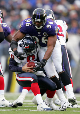 BALTIMORE - DECEMBER 04:  Quarterback David Carr #8 of the Houston Texans is sacked by Adalius Thomas #96 of the Baltimore Ravens during the first half on December 4, 2005 at M&T Bank Stadium in Baltimore, Maryland.  (Photo by Jamie Squire/Getty Images)