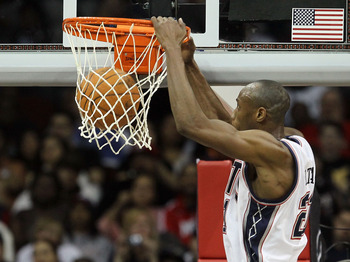 NEWARK, NJ - APRIL 03:  Travis Outlaw #21 of the New Jersey Nets dunks against the Miami Heat at the Prudential Center on April 3, 2011 in Newark, New Jersey.The Heat defeated the Nets 108-94.NOTE TO USER: User expressly acknowledges and agrees that, by d