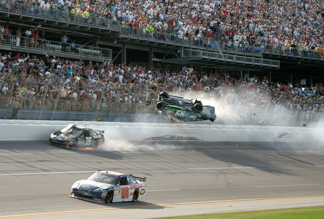 TALLADEGA, AL - APRIL 26:  Carl Edwards, driver of the #99 Claritin Ford, goes airborne as Ryan Newman, driver of the #39 Steweart-Haas Racing Chevrolet suffers damage and Dale Earnhardt Jr., driver of the #88 National Guard / AMP Energy Chevrolet drives