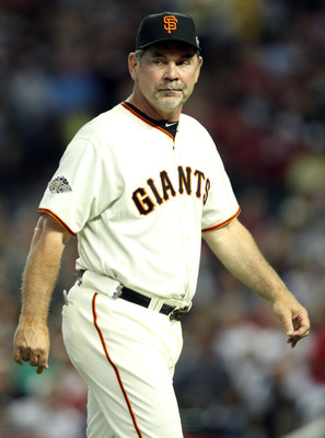 PHOENIX, AZ - JULY 12:  National League All-Star manager Bruce Bochy #15 of the San Francisco Giants goes to the mound for a pitcher change during the 82nd MLB All-Star Game at Chase Field on July 12, 2011 in Phoenix, Arizona.  (Photo by Christian Peterse