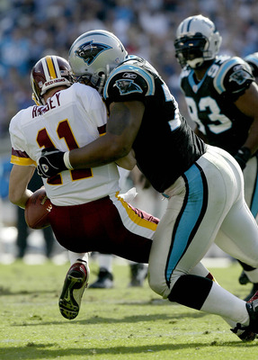 CHARLOTTE, NC - NOVEMBER 16:  Patrick Ramsey #11 of the Washington Redskins is sacked by Kris Jenkins #77 of the Carolina Panthers on November 16, 2003 at Ericsson Stadium in Charlotte, North Carolina.  (Photo by Craig Jones/Getty Images)