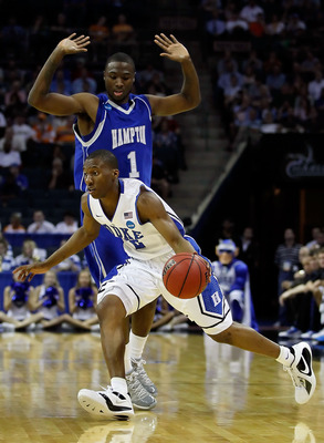 CHARLOTTE, NC - MARCH 18:  Nolan Smith #2 of the Duke Blue Devils moves the ball against Darrion Pellum #1 of the Hampton Pirates in the first half during the second round of the 2011 NCAA men's basketball tournament at Time Warner Cable Arena on March 18