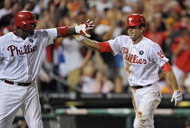 PHILADELPHIA, PA - JULY 26: Chase Utley #26 of the Philadelphia Phillies gets congratulated by teammate Ryan Howard #6 after Utley hit an inside-the-park home run during the game against the San Francisco Giants at Citizens Bank Park on July 26, 2011 in P