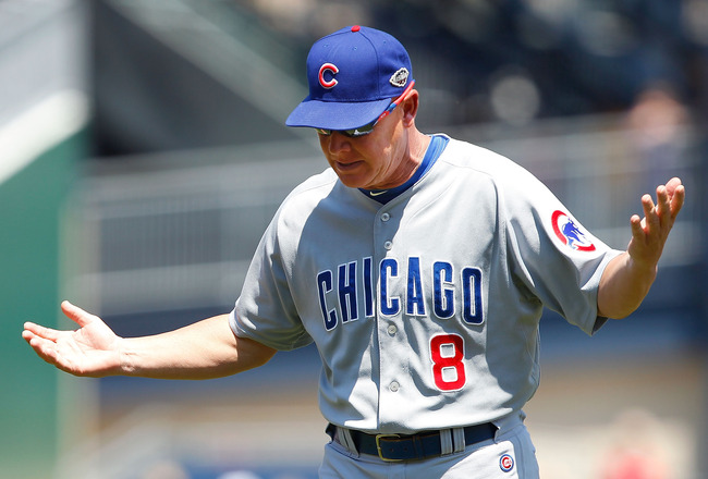 PITTSBURGH, PA - JULY 10:  Manager Mike Quade #8 of the Chicago Cubs gestures to the umpires about a play at second base against the Pittsburgh Pirates during the game on July 10, 2011 at PNC Park in Pittsburgh, Pennsylvania.  (Photo by Jared Wickerham/Ge