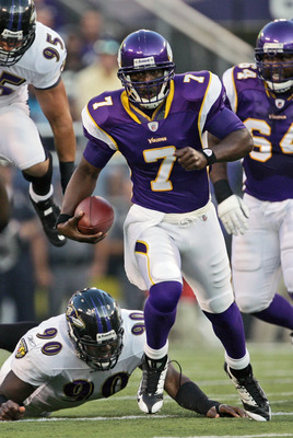 BALTIMORE - AUGUST 16: Quarterback Tarvaris Jackson #7 of the Minnesota Vikings runs for a first down during the game against the Baltimore Ravens on August 16, 2008 at M & T Bank Stadium in Baltimore, Maryland. (Photo by Drew Hallowell/Getty Images)
