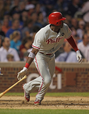 CHICAGO, IL - JULY 19:  Domonic Brown #9 of the Philadelphia Phillies hits a double in the 5th inning  against the Chicago Cubs at Wrigley Field on July 19, 2011 in Chicago, Illlinois.  (Photo by Jonathan Daniel/Getty Images)