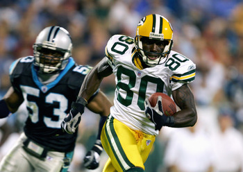 CHARLOTTE, NC - OCTOBER 03:  Donald Driver #80 of the Green Bay Packers carries the ball during the game with the Carolina Panthers on October 3, 2005 at Bank of America Stadium in Charlotte, North Carolina. The Panthers won 32-29. (Photo By Streeter Leck