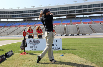 FORT WORTH, TX - OCTOBER 13:  Jimmie Johnson, driver of the #48 Lowe's/Jimmie Johnson Foundation Chevrolet, hits a tee shot from the infield grass at Texas Motor Speedway on October 13, 2010 in Fort Worth, Texas.  (Photo by Tom Pennington/Getty Images)