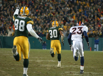 GREEN BAY, WI - DECEMBER 28: Running back Ahman Green #30 of the Green Bay Packers takes off on a 98 yard run for a touchdown as teammate Bubba Franks #88 and cornerback Willie Middlebrooks #23 of the Denver Broncos trail the play during a game December 2