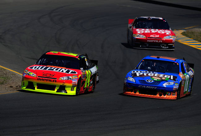 SONOMA, CA - JUNE 26:  Jeff Gordon, driver of the #24 DuPont Chevrolet, races Kyle Busch, driver of the #18 M&M's Pretzel Toyota, and Tony Stewart, driver of the #14 Office Depot/Mobil 1 Chevrolet, during the NASCAR Sprint Cup Series Toyota/Save Mart 350