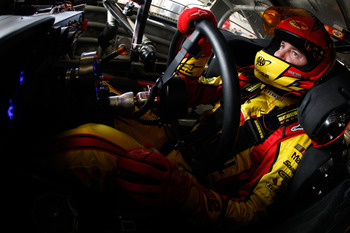 DAYTONA BEACH, FL - JUNE 30:  Kurt Busch, driver of the #22 Shell / Pennzoil Dodge, sits in his car during practice for the NASCAR Sprint Cup Series COKE ZERO 400 Powered by Coca-Cola at Daytona International Speedway on June 30, 2011 in Daytona Beach, Fl