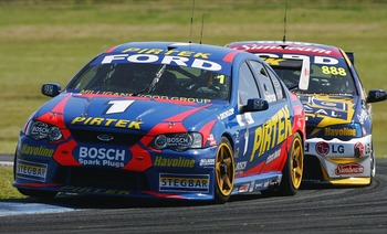 PHILLIP ISLAND, AUSTRALIA - NOVEMBER 26:  Marcos Ambrose of the Stone Brothers Racing Team is followed by Craig Lowndes of the Triple Eight Racing Team during the final round of the V8 Supercar Championship Series at the Phillip Island Grand Prix Circuit