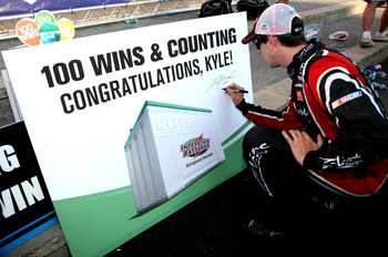 LOUDON, NH - JULY 16:  Kyle Busch, driver of the #18 Z-Line Designs Toyota, signs his autograph in Victory Lane after winning the NASCAR Nationwide Series New England 200 at New Hampshire Motor Speedway on July 16, 2011 in Loudon, New Hampshire. Busch's w