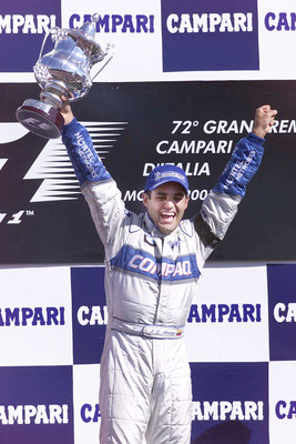 16 Sep 2001: Juan Pablo Montoya of Columbia of BMW Williams celebrates on the podium after winning the Italian Grand Prix at Monza, Italy.  Mandatory Credit: Clive Mason/ALLSPORT