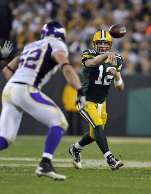 GREEN BAY, WI - OCTOBER 24:  Aaron Rodgers #12 of the Green Bay Packers passes while under pressure from Chad Greenway #52 of the Minnesota Vikings during their game at Lambeau Field on October 24, 2010 in Green Bay, Wisconsin. (Photo by Jim Prisching/Get