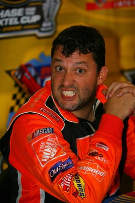 LOUDON, NH - SEPTEMBER 17:  Tony Stewart, driver of the #20 The Home Depot Chevrolet, makes a funny face for the camera during a press confrence following the NASCAR Nextel Cup Series Sylvania 300 on September 17, 2006 at New Hampshire International Speed
