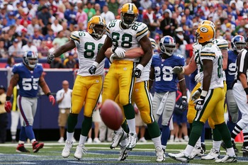 EAST RUTHERFORD, NJ - SEPTEMBER 16:  Bubba Franks #88 of the Green Bay Packers is congratulated by team mates after scoring a touchdown against the New York Giants at Giants Stadium September 16, 2007 in East Rutherford, New Jersey.  (Photo by Chris McGra