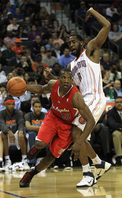 CHARLOTTE, NC - MARCH 07:  Eric Bledsoe #12 of the Los Angeles Clippers drives past DJ White #8 of the Charlotte Bobcats during their game at Time Warner Cable Arena on March 7, 2011 in Charlotte, North Carolina. NOTE TO USER: User expressly acknowledges