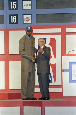 24 Jun 1998: A picture of the 1st Pick Michael Olowokandi by the Los Angeles Clippers shaking hands with David Stern the NBA Commissioner during the NBA Draft at the General Motors Palace in Vancouver, Canada. FOR EDITORIAL USE ONLY