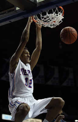 ROSEMONT, IL - FEBRUARY 19: Cleveland Melvin #12 of the DePaul Blue Demons dunks the ball against the Villanova Wildcats at the Allstate Arena on February 19, 2011 in Rosemont, Illinois. Villanova defeated DePaul 77-75 in overtime. (Photo by Jonathan Dani
