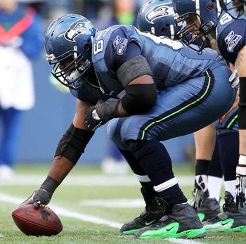 SEATTLE, WA - JANUARY 08:  Center Chris Spencer #65 of the Seattle Seahawks prepares to snap the football against the New Orleans Saints during the 2011 NFC wild-card playoff game at Qwest Field on January 8, 2011 in Seattle, Washington.  (Photo by Otto G