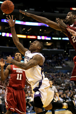 LOS ANGELES, CA - MARCH 10:  Isaiah Thomas #2 of the Washington Huskies goes up for a shot in the lane in the first half against the Washington State Cougars in the quarterfinals of the 2011 Pacific Life Pac-10 Men's Basketball Tournament at Staples Cente