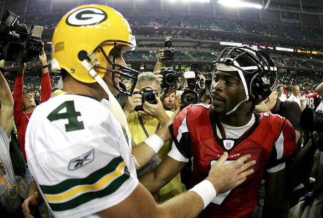 ATLANTA - NOVEMBER 13:  Brett Favre #4 of the Green Bay Packers shakes hands with Michael Vick #7 of the Atlanta Falcons after their game on November 13, 2005 at the Georgia Dome in Atlanta, Georgia. The Packers defeated the Falcons 33-25.   (Photo by Str