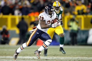 GREEN BAY, WI - JANUARY 02: Chester Taylor #29 of the Chicago Bears carries the ball against the Green Bay Packers at Lambeau Field on January 2, 2011 in Green Bay, Wisconsin.  (Photo by Matthew Stockman/Getty Images)