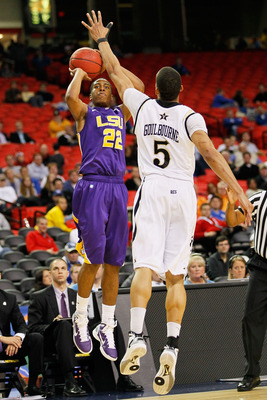 ATLANTA, GA - MARCH 10:  Ralston Turner #22 of the LSU Tigers shoots over Lance Goulbourne #5 of the Vanderbilt Commodores during the first round of the SEC Men's Basketball Tournament at the Georgia Dome on March 10, 2011 in Atlanta, Georgia.  (Photo by