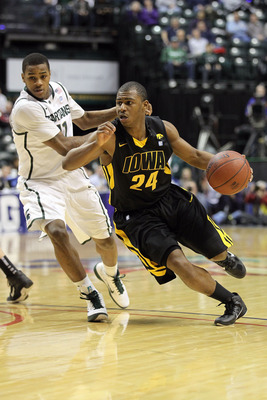 INDIANAPOLIS, IN - MARCH 10:  Bryce Cartwright #24 of the Iowa Hawkeyes drives against Keith Appling #11 of the Michigan State Spartans during the first round of the 2011 Big Ten Men's Basketball Tournament at Conseco Fieldhouse on March 10, 2011 in India