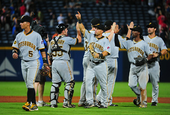 ATLANTA - JULY 25: Members of the Pittsburgh Pirates celebrate after the game against the Atlanta Braves at Turner Field on July 25, 2011 in Atlanta, Georgia. (Photo by Scott Cunningham/Getty Images)