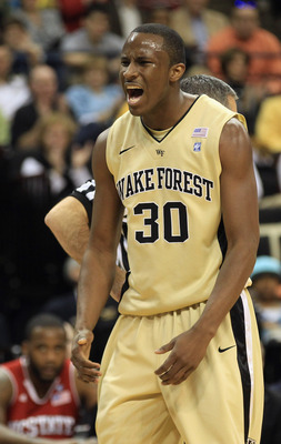 WINSTON SALEM, NC - FEBRUARY 13:  Travis McKie #30 of the Wake Forest Demon Deacons reacts to a play during their game against the North Carolina State Wolfpack at Lawrence Joel Coliseum on February 13, 2011 in Winston Salem, North Carolina.  (Photo by St