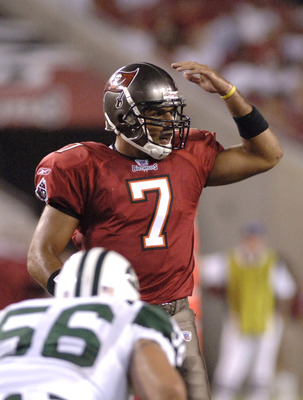 Tampa Bay Buccaneers quarterback Bruce Gradkowski calls a play against the New York Jets in a pre-season game Raymond James Stadium in Tampa Florida on August 11, 2006.  The Bucs defeated the Jets 16 - 3.  (Photo by Al Messerschmidt/Getty Images)