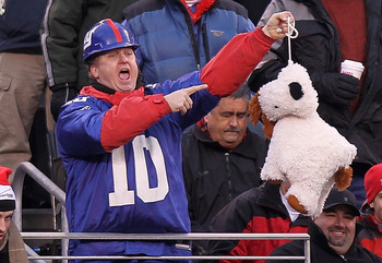 EAST RUTHERFORD, NJ - DECEMBER 19: A fan of the New York Giants holds up a stuffed dog in a noose during the game against the Philadelphia Eagles at New Meadowlands Stadium on December 19, 2010 in East Rutherford, New Jersey.  (Photo by Nick Laham/Getty I