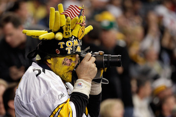 ARLINGTON, TX - FEBRUARY 06:  A Pittsburgh Steelers fan take a picture before the Steelers take on the Green Bay Packers in Super Bowl XLV at Cowboys Stadium on February 6, 2011 in Arlington, Texas.  (Photo by Rob Carr/Getty Images)
