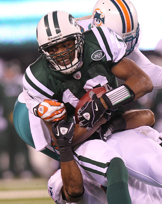 EAST RUTHERFORD, NJ - DECEMBER 12: Brad Smith #16 of the New York Jets is tackled by the Miami Dolphins defense at New Meadowlands Stadium on December 12, 2010 in East Rutherford, New Jersey.  (Photo by Nick Laham/Getty Images)