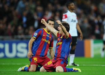 LONDON, ENGLAND - MAY 28:  Lionel Messi (R) of FC Barcelona celebrates as David Villa scores the third goal with teammate Sergio Busquets during the UEFA Champions League final between FC Barcelona and Manchester United FC at Wembley Stadium on May 28, 20