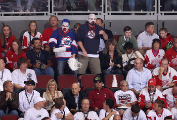 GLENDALE, AZ - APRIL 20:  Fans dressed in Winnipeg Jets uniforms attend Game Four of the Western Conference Quarterfinals between the Detroit Red Wings and the Phoenix Coyotes during the 2011 NHL Stanley Cup Playoffs at Jobing.com Arena on April 20, 2011