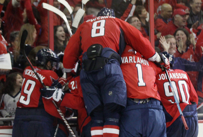 WASHINGTON, DC - APRIL 13: The Washington Capitals celebrate the game winning goal by Alexander Semin #28 at 18:24 of overtime against the New York Rangers in Game One of the Eastern Conference Quarterfinals during the 2011 NHL Stanley Cup Playoffs at Ver