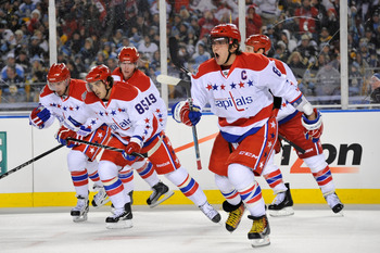 PITTSBURGH, PA - JANUARY 01:  Captain Alex Ovechkin #8 of the Washington Capitals celebrates a goal by teammate Mike Knuble #22 with fellow teammates during the second period of the game against the Pittsburgh Penguins at the 2011 NHL Bridgestone Winter C