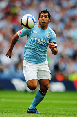 LONDON, ENGLAND - MAY 14:  Carlos Tevez of Manchester City runs with the ball during the FA Cup sponsored by E.ON Final match between Manchester City and Stoke City at Wembley Stadium on May 14, 2011 in London, England.  (Photo by Shaun Botterill/Getty Im