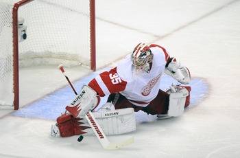 SAN JOSE, CA - MAY 12: Goalie Jimmy Howard #35 the Detroit Red Wings makes a save in the second period in Game Seven of the Western Conference Semifinals  during the 2011 NHL Stanley Cup Playoffs at the HP Pavilion on May 12, 2011 in San Jose, California.
