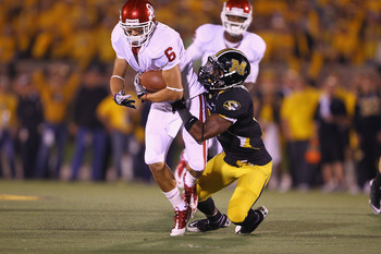 COLUMBIA, MO - OCTOBER 23: Jasper Simmons #9 tackles Cameron Kenney #6 of the Oklahoma Sooners at Faurot Field/Memorial Stadium on October 23, 2010 in Columbia, Missouri.  The Tigers beat the Sooners 36-27.  (Photo by Dilip Vishwanat/Getty Images)