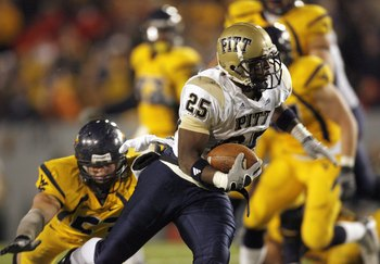 MORGANTOWN, WV - DECEMBER 1: LeSean McCoy #25 of the Pittsburgh Panthers carries the ball during the game against the West Virginia Mountaineers at Milan Puskar Stadium on December 1, 2007 in Morgantown, West Virginia. Pittsburgh defeated West Virginia 13